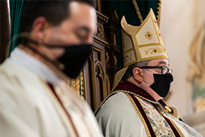 Bishop Michael Olson is seen wearing a mask while leading deacon candidates in vespers June 24, 2020. (NTC/Juan Guajardo)