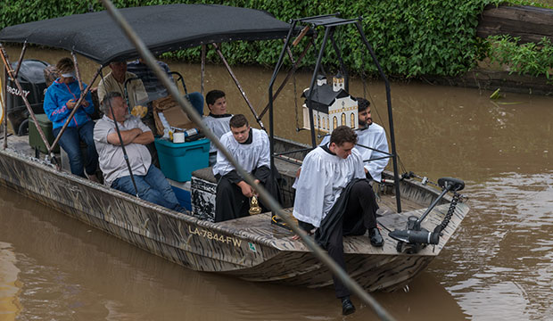 A boat containing incense arrives in St. Martinville, La., during the Aug. 15, 2017, Fete-Dieu du Teche procession.