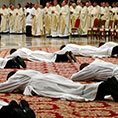 Candidates for the priesthood lie on the floor as Pope Francis celebrates an ordination Mass in St. Peter's Basilica at the Vatican May 12, 2019.