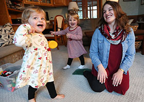 Alonna Mertz plays with her twin daughters, Lilly and Eve,