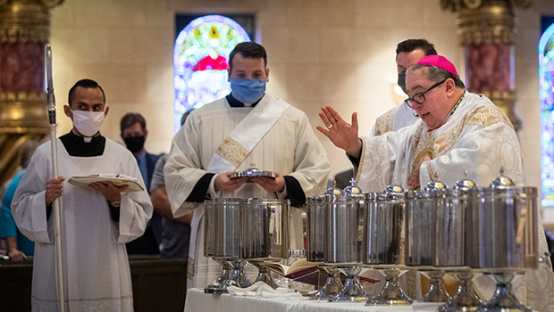 Bishop Michael Olson blesses oils to be used in sacraments throughout the diocese, during the Chrism Mass at St. Elizabeth Ann Seton in Keller. (NTC/Rodger Mallison)