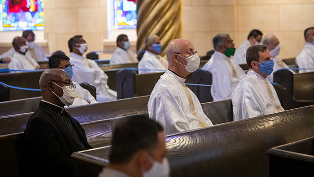 Priests are masked and socially distanced as Bishop Michael F. Olson celebrates the Chrism Mass at St. Elizabeth Ann Seton Catholic Church in Keller, May 28, 2020. (NTC/Rodger Mallison)