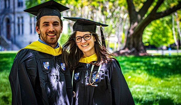 man and woman in cap and gown