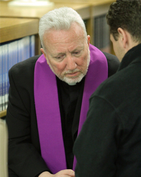 Father Thomas Fusco, pastor at St. Edward the Confessor Parish in Syosset, N.Y., listens to a penitent's confession during a Catholic men's conference at Holy Trinity Diocesan High School in Hicksville, N.Y., in 2012. Each Lent parishes and dioceses acro ss the U.S. invite inactive Catholics to return to church and to take advantage of sacrament of reconciliation. (CNS photo/Gregory A. Shemitz)