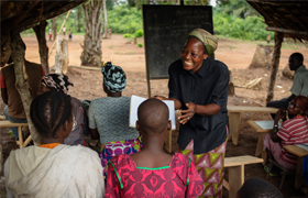 Sister Angelique Namaika, a member of the Augustine Sisters of Dungu and Doruma, smiles as she instructs a literacy class Aug. 1 in Congo. Sister Angelique received the 2013 Nansen Refugee Award from the U.N. High Commissioner for Refugees Sept. 17 for h er work with women forced to leave their homes in northeastern Congo because of long-term civil strife. (CNS photo/Brian Sokol, courtesy UNHR)