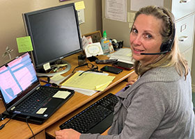 CCFW staff member Holly Lane of the Northeast Campus in Colleyville continues to answer incoming calls from community members in need.
