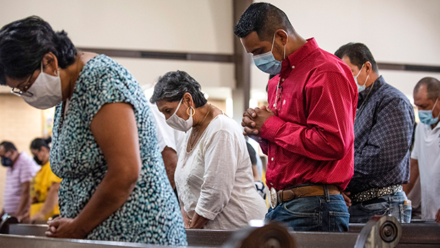 Parishioners bow their heads in prayer during Mass at Our Lady of Guadalupe Parish in Wichita Falls Aug. 30, 2020. (NTC/Ben Torres)