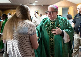 Bishop Michael Olson greets members of the congregation after celebrating a Mass dedicated to single people at St. Michael Parish in Bedford. (NTC/Rodger Mallison)