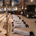men lay prostrate