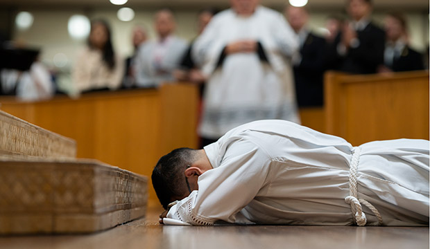 Pedro Martinez lays prostrate during his ordination to the transitional diaconate as a symbol of laying down his life for ministry. (NTC/Juan Guajardo)