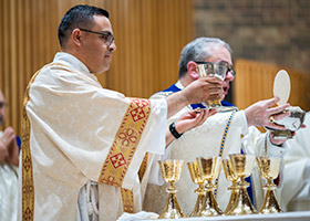 Deacon Pedro Martinez assists Bishop Olson at the altar. (NTC/Juan Guajardo)