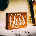 "wood plaque saying ""bless"""