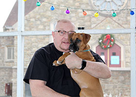 Father John Gayton and Roxie