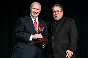 Don Miller, former superintendent of Catholic Schools in the Diocese of Fort Worth (left) is shown receiving the Diocesan Leadership Award from Bishop Michael Olson in 2015. (NTC/Juan Guajardo)
