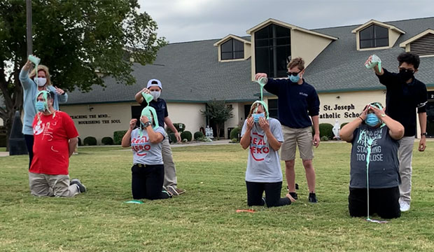 slime is poured on teachers' heads