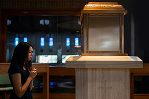 A local Catholic prays before the Blessed Sacrament in the tabernacle at Most Blessed Sacrament Church in Arlington. (NTC/Juan Guajardo)