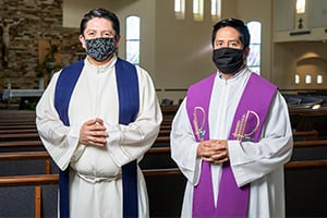 Father Oscar Sanchez Olvera, CORC (left), and Father Alejandro Lopez Chavez, CORC, have used creative means minister to their faithful at Immaculate Heart of Mary Parish in Fort Worth. (NTC/Juan Guajardo)