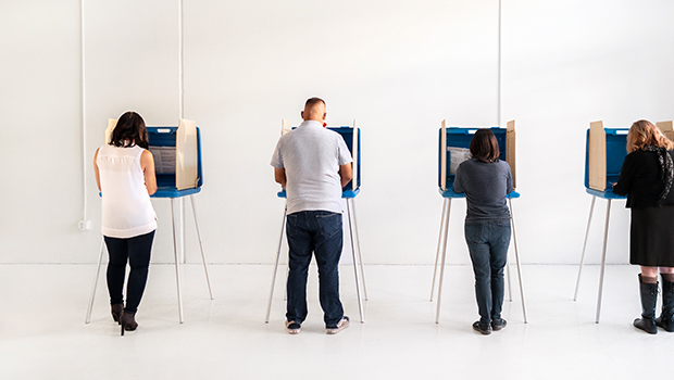 three voters at voting booth