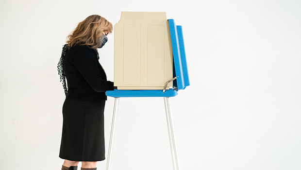 woman at voting booth