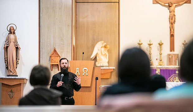 At Nativity of the Blessed Virgin Mary Parish in Penelope, Father Joseph Keating leads formation for parents in the nave of the church. At the same time, youngsters receive religious education from catechists in parish classrooms. (NTC/Juan Guajardo)