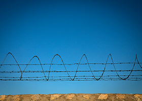 A border fence is seen Sept. 24, 2019, between El Paso, Texas, and Ciudad Juarez, Mexico. Meeting in Baltimore for their fall general assembly, the U.S. bishops heard a grim report Nov. 12 on the policy landscape facing immigrants and refugees trying to find shelter in the United States. (CNS photo/Tyler Orsburn)