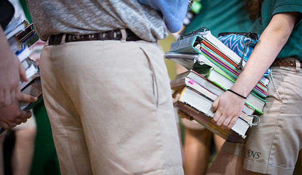 kids carrying schoolbooks