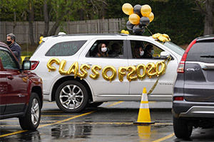 A senior and members of her family participate in a drive-thru Senior Day celebration at St. Anthony's High School in South Huntington, N.Y. May 8, 2020, amid the COVID-19 pandemic. (CNS photo/Gregory A. Shemitz, Long Island Catholic)