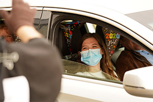 Senior Gina Marie Occhipinti takes in the festivities during a drive-thru Senior Day celebration at St. Anthony's High School in South Huntington, N.Y. May 8, 2020, amid the COVID-19 pandemic. (CNS photo/Gregory A. Shemitz, Long Island Catholic)