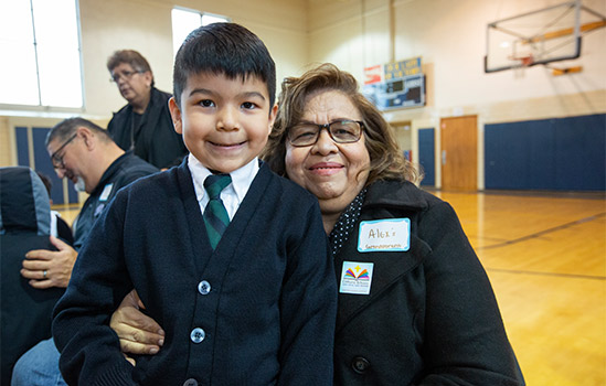 First-grader Alex Alvarado gets a hug from grandmother Raquel Alvarado during Grandparents Day at Our Lady of Victory Catholic School January 29. (NTC/Rodger Mallison)