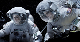 "Sandra Bullock and George Clooney star in a scene from the movie ""Gravity."" The Catholic News Service classification is A-III -- adults. The Motion Picture Association of America rating is PG-13 -- parents strongly cautioned. Some material may be inappro priate for children under 13. (CNS photo/Warner Bros.)"
