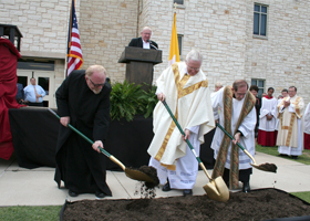 Fr. Dennis Smith, Msgr. E. James Hart, and Fr. James McGhee shovel dirt for the groundbreaking