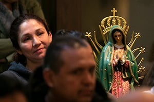 Anabel Casique sits with her statue of Mary as she attends Mass on the Feast of Our Lady of Guadalupe at Immaculate Heart of Mary Church in Fort Worth December 12, 2018. (NTC/Rodger Mallison)