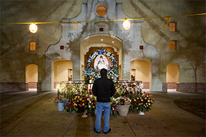 A worshipper pauses outside the church before a Mass on the Feast of Our Lady of Guadalupe at Immaculate Heart of Mary Church in Fort Worth December 12, 2018. (NTC/Rodger Mallison)
