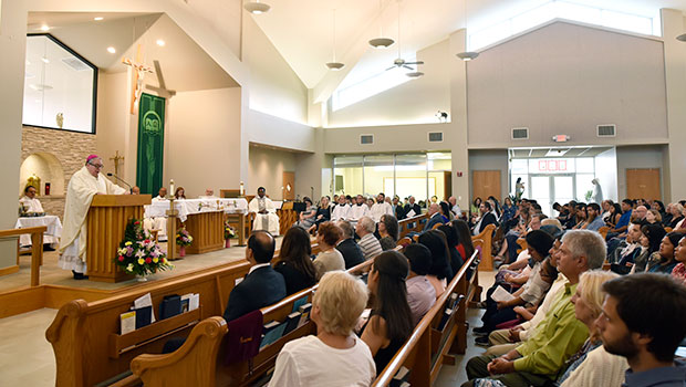 Bishop Michael Olson delivers his homily during a dedication celebration at Holy Trinity Parish in Azle. (NTC/Ben Torres)