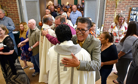 Fr. Wilson Lucka is congratulated by parishioners after being appointed pastor of Holy Trinity Parish by Bishop Michael Olson. (NTC/Ben Torres)