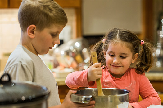 Children in Detroit, Mich., help prepare a family meal at their home Nov. 14, 2019. Longtime home-schooling parents say suddenly having kids at home for class work can be a rewarding family experience that allows more one-on-one time with children. (CNS photo/Melissa Moon, Detroit Catholic)