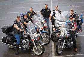 Knights on Bikes from the Diocese of Tulsa, Okla., pose for a photo in Tulsa in May. Pictured from left are Charlie Hoy and Matt Buckendorf from Holy Family, Jerry Smittle, Al Yowell from St. Anne, state chaplain Father Jim Caldwell, state president Mark Cearley and Bob Mogelnicki from St. Bernard. Theirs is a motorcycle ministry dedicated to improving the image of bikers and promoting safety and Christian values. (CNS photo/Dave Crenshaw, Eastern Oklahoma Catholic)