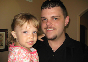 David Mueller, a healthy 31-year-old who died in February after four days of illness caused by Influenza B, is pictured in 2011 with his daughter, Autumn Rose. A campaign to educate the public about the flu and the needs for immunizations has been organi zed in Mueller's name by councils of the Knights of Columbus in the Diocese of Allentown, Pa. Council leaders hope Knights take the effort nationwide. (CNS photo/courtesy Mueller family) (Oct. 15, 2013)