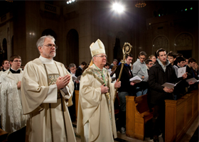 Bishop Kevin J. Farrell of Dallas, center, arrives to celebrate the closing Mass of the National Prayer Vigil for Life at the Basilica of the National Shrine of the Immaculate Conception in Washington Jan. 25. The vigil, held before the annual March for Life, marked the 40th anniversary of the Supreme Court's Roe v. Wade decision that legalized abortion across the nation. (CNS photo/Nancy Phelan Wiechec)