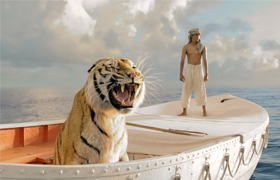"Suraj Sharma and a fierce Bengal tiger named Richard Parker are seen in the movie ""Life of Pi."" The Catholic News Service classification is A-III -- adults. The Motion Picture Association of America rating is PG -- parental guidance suggested. Some mater ial may not be suitable for children. (CNS photo/Fox)"