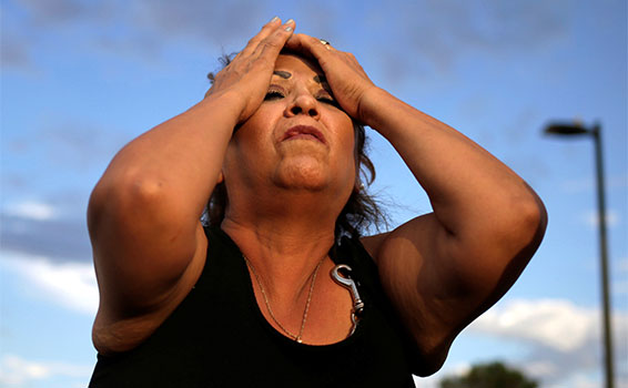 A woman reacts after a mass shooting at a Walmart store in El Paso, Aug. 3, 2019.