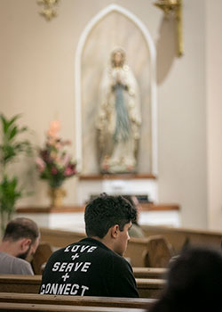 Participants in the  Metanoia Retreat join parishioners in Eucharistic Adoration at Saint Ann Catholic Church in Burleson, Sunday, July 21, 2019.