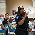 "A Capitol Police officer warns demonstrators of their potential arrest July 18, 2019, during a ""Catholic Day of Action for Immigrant Children"" at the Russell Senate Office Building in Washington."