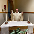 Father Jeff Dauses with paten and chalice