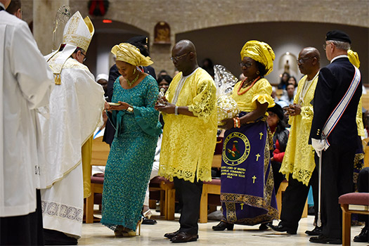 Bishop Michael Olson receives the gifts of bread and wine from members of the Ghanaian community during the annual Dr. Martin Luther King, Jr. Diocesan Memorial Mass. (NTC/Ben Torres)