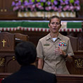 In this 2015 file photo, Navy Cmdr. Tracie Severson at the U.S. Naval Academy in Annapolis, Md., tells a group of priests how military chaplains have impacted her life.
