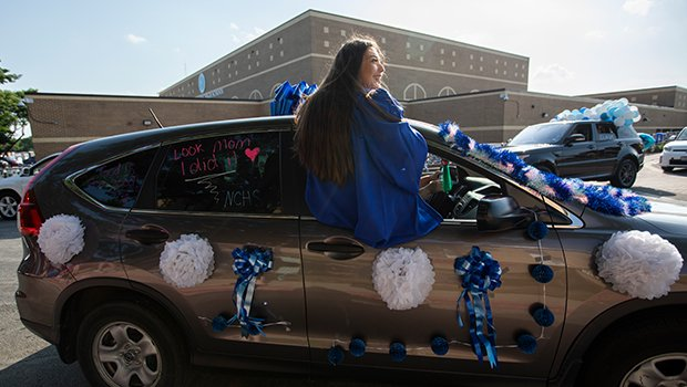 Alicia Flores rides in the window of her car as graduating seniors from Nolan High School parade through the school grounds May 22, 2020. (NTC/Rodger Mallison)