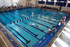 Nolan High School and John Paul II High School swimmers compete at the first swim meet hosted at the new natatorium on the Nolan campus in Fort Worth Oct. 24, 2020. (NTC/Ben Torres)