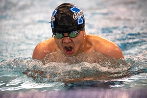 Nolan High School swimmer Matthew Nguyen competes in the breast stroke against John Paul II High School at the first swim meet hosted in the Nolan Catholic Natatorium in Fort Worth. (NTC/Ben Torres)