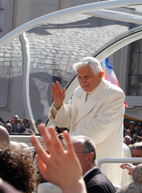 Pope Benedict XVI waves as he leaves his final general audience in St. Peter's Square at the Vatican Feb. 27. (CNS photo/Paul Haring)